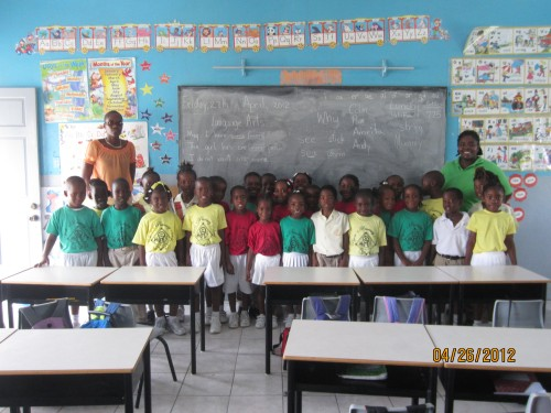 The Kindergarten class at Pigotts School in Antigua gets a tile floor.