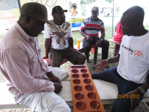 Warri, a game that originated in Africa, is a favorite in Antigua.